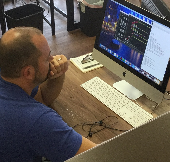 A Website Designer Works on Coding