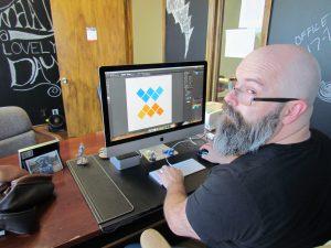 Web Designer Working on Brand Development Services